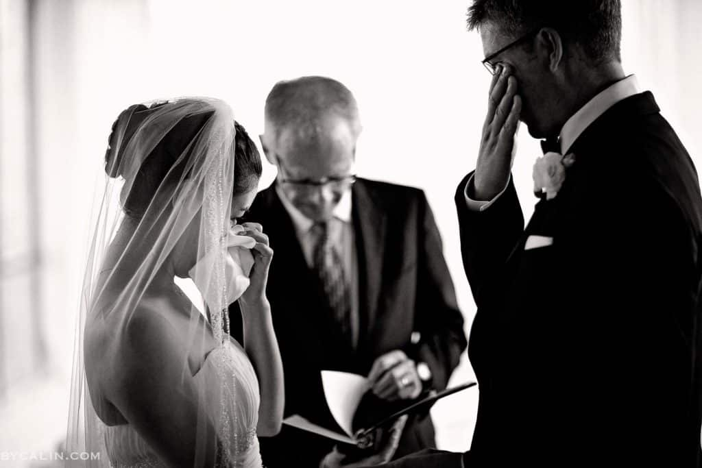 Bride and groom shedding a tear